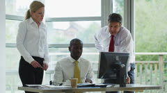 Business team meeting in a light and natural office environment - stock footage
