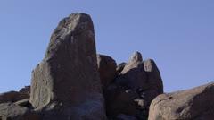 Pan from rocky peak to mountain view - Joshua Tree National Park Stock Footage