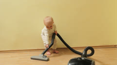 Funny little baby clean the house, get tired  Stock Footage