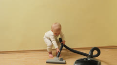 Stock Video Footage of Funny little baby doing heavy work, ask his mother help to clean