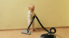 Active baby making house clean with vacuum cleaner Stock Footage