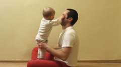 Father playing with his baby indoor Stock Footage