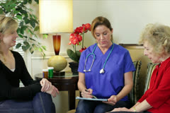 Home health care nurse going over prescriptions - stock footage
