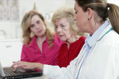 Doctor showing test results to patient Stock Footage