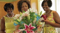 Women arranging flowers and smile at camera Stock Footage