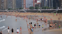 Summer crowd on beach time lapse Stock Footage