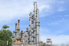 Oil and gas refinery plant with distillation column and tank Stock Photos