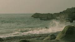 Waves On Rocky Beach at Dusk Stock Footage