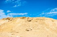 Stock Photo of Sand dunes and rocks, Sahara Desert