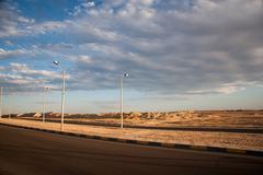 Empty asphalt road with cloudy sky and sunlight Stock Photos