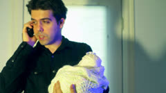 Father on phone baby stay at home dad Stock Footage