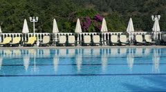 The swimming pool sunbeds and flowers at luxury hotel, Fethiye, Turkey Stock Footage