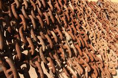 Old rusty ship anchor chain links close up. Stock Photos
