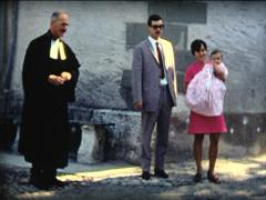 8 MM - baby baptized family picture with pastor Stock Footage