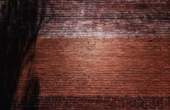Red brick wall in alley backdrop Stock Photos