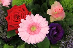 wedding arrangement in red, pink and purple - stock photo