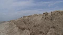 Eroding shoreline, sandy ridge at North Sea beach - wide shot + pan Stock Footage