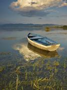 Boat on sunset Stock Photos