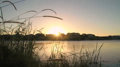Canal homes sunset time lapse Stock Footage
