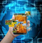 holding mobile smart phone with world technology background - stock illustration
