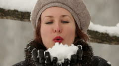 Young attractive woman have fun in a winter park Stock Footage