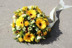 yellow sympathy flowers - stock photo