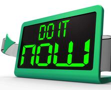 do it  now clock shows urgency for action - stock illustration