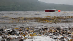 Small boat on loch Stock Footage