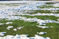 Stock Photo of snow on outdoor soccer field