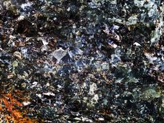 Rock with crystal and metallic inclusions Stock Photos