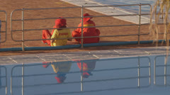Life guards by pool Stock Footage