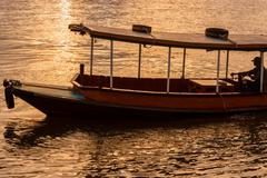 Boat and sunset Stock Photos