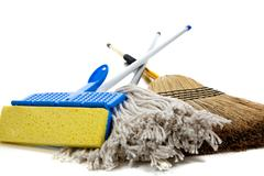 Stock Photo of sponge mop, broom and string mop on white