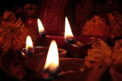 Stock Photo of four earthen lamps(diya) on diwali