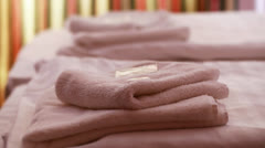 Towels, shampoo, soap on a bed Stock Footage