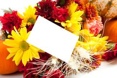 Autumn floral arrangement on white with a note back Stock Photos