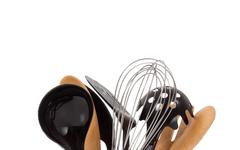 an array of kitchen utensils on white - stock photo