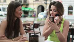 Pretty woman applying makeup in cafe, steadicam shot HD Stock Footage