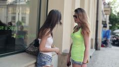 Young girlfriends meeting in the city, steadicam shot HD Stock Footage