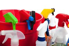 cleaning supplies in a red bucket on white - stock photo
