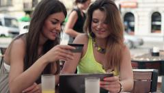 Girlfriends doing online shopping on tablet in cafe HD Stock Footage