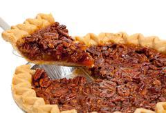 a whole pecan pie on white - stock photo