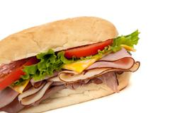 assorted meat sandwich with fixings on a hoagie - stock photo