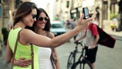 Tourists, girlfriends taking photo with photo camera in city HD Stock Footage