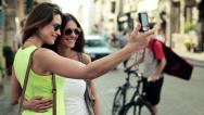 Stock Video Footage of Tourists, girlfriends taking photo with photo camera in city HD