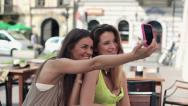 Stock Video Footage of Happy girlfriends taking photo with cellphone in cafe HD