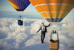 equilibrist businessma - stock photo