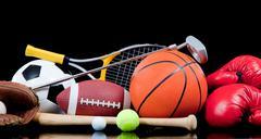 assorted sports equipment on black - stock photo