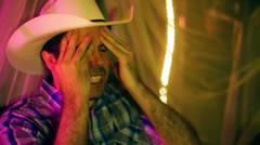 Cowboy southern dixie headache head pain stress Stock Footage