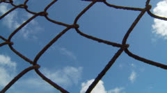 Cloud Time lapse Through Fence Stock Footage